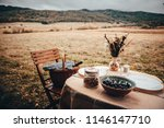vintage colored photo. table...   Shutterstock . vector #1146147710