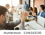 Small photo of Glad partners clapping hands to colleague making presentation about profit increasing, copy space