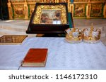 golden crowns and bible and... | Shutterstock . vector #1146172310