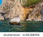 one stone in water near... | Shutterstock . vector #1146188456