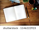 open blank white notebook on... | Shutterstock . vector #1146222923
