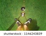legs of golf player with putter ... | Shutterstock . vector #1146243839