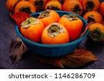 ripe orange persimmon fruit and ... | Shutterstock . vector #1146286709
