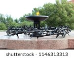 eternal flame surrounded by... | Shutterstock . vector #1146313313