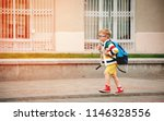 happy smiling kid in glasses is ... | Shutterstock . vector #1146328556