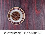 an old cup full of coffee beans ... | Shutterstock . vector #1146338486