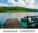 wooden pier or jetty and a boat ...   Shutterstock . vector #1146352313