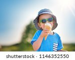 happy child eating ice cream... | Shutterstock . vector #1146352550