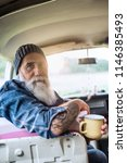 portrait of an old hipster... | Shutterstock . vector #1146385493