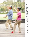 Senior Chinese Couple Doing Ta...
