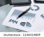 financial charts and graphs on... | Shutterstock . vector #1146414809
