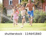 Family Running Through Garden...