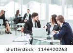 employees of the company work... | Shutterstock . vector #1146420263
