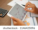 closeup of trader working with... | Shutterstock . vector #1146425096