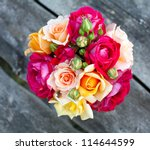 Stock photo bouquet of roses on wooden table 114644599