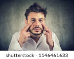 young tired funny looking man... | Shutterstock . vector #1146461633