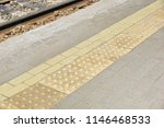 yellow tactile path for people... | Shutterstock . vector #1146468533