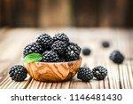 blackberries on wooden table in ... | Shutterstock . vector #1146481430