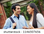 two students talking outside | Shutterstock . vector #1146507656