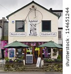 Small photo of KESWICK, ENGLAND - JULY 26: The Lakeland Pedlar cafe on July 26, 2012 in Keswick, England. Keswick is a tourism hotspot of the Lake District, especially popular with walkers in the summer months.