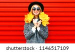pretty happy girl holds yellow... | Shutterstock . vector #1146517109