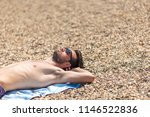 young man laying on the sandy... | Shutterstock . vector #1146522836