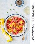 sliced fresh tomato and basil... | Shutterstock . vector #1146678500
