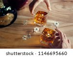 close up of two men clink... | Shutterstock . vector #1146695660