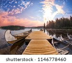 pier with canoes on the edge of ... | Shutterstock . vector #1146778460
