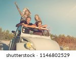 group of happy friends in a car ... | Shutterstock . vector #1146802529