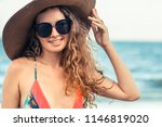 happy young woman wearing... | Shutterstock . vector #1146819020