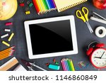 school supplies on blackboard... | Shutterstock . vector #1146860849