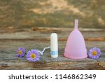 menstrual cup and tampons on... | Shutterstock . vector #1146862349