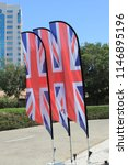 union jack flags blowing in the ... | Shutterstock . vector #1146895196