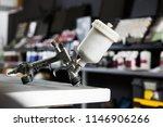 closeup of paint spray gun on... | Shutterstock . vector #1146906266