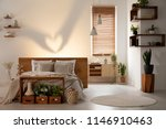 real photo of a warm bedroom... | Shutterstock . vector #1146910463