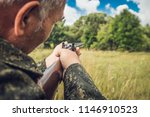 hunter with a gun | Shutterstock . vector #1146910523