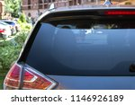 Stock photo back window of a car parked on the street in summer sunny day rear view mock up for sticker or 1146926189