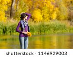 young woman in the hat is... | Shutterstock . vector #1146929003