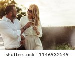 romantic couple toasting wine... | Shutterstock . vector #1146932549