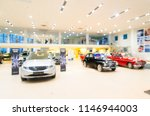 blurred dealership store  with... | Shutterstock . vector #1146944003