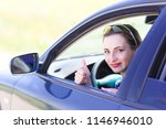 young smiling girl driving a... | Shutterstock . vector #1146946010