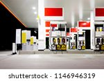 gas station pumps at night | Shutterstock . vector #1146946319
