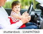 little child is sitting on the... | Shutterstock . vector #1146947063