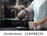 anonymous female filling mug... | Shutterstock . vector #1146988133