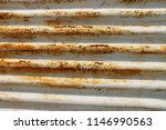 rusty corrugated metal roofing | Shutterstock . vector #1146990563