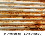 rusty corrugated metal roofing | Shutterstock . vector #1146990590