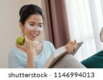 lovely asian lady with ripe... | Shutterstock . vector #1146994013