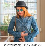 stylish redhead woman wearing... | Shutterstock . vector #1147003490