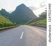 summer woods road | Shutterstock . vector #1147011440